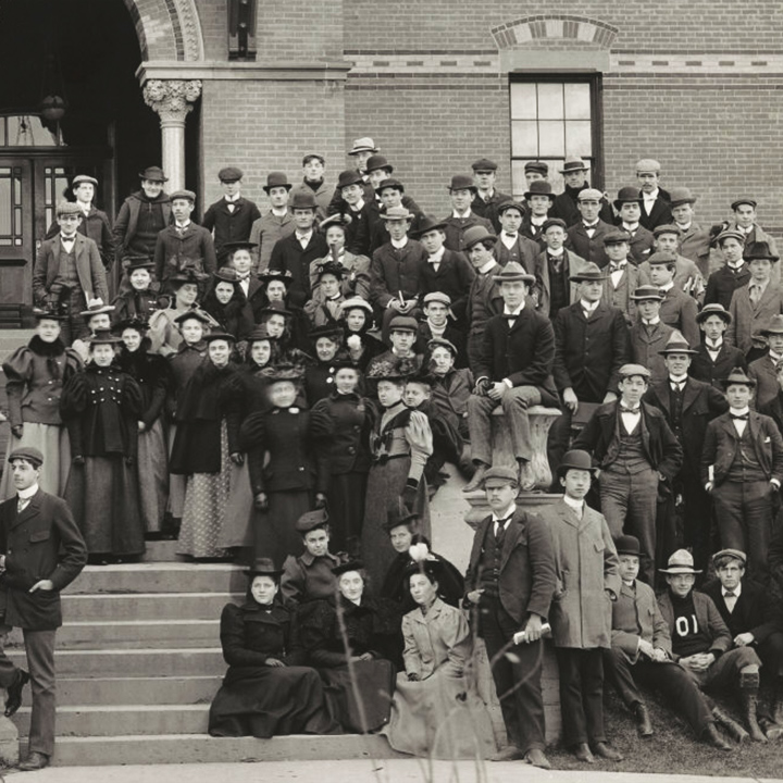1875 class photo showing students posed on building steps