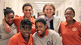 Maisie Wright '06 with students at the KIPP Blytheville school she started