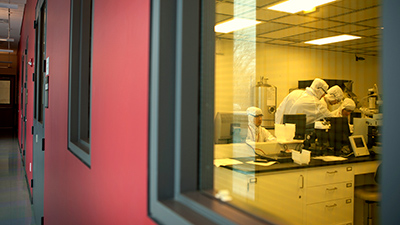 researchers in a cleanroom