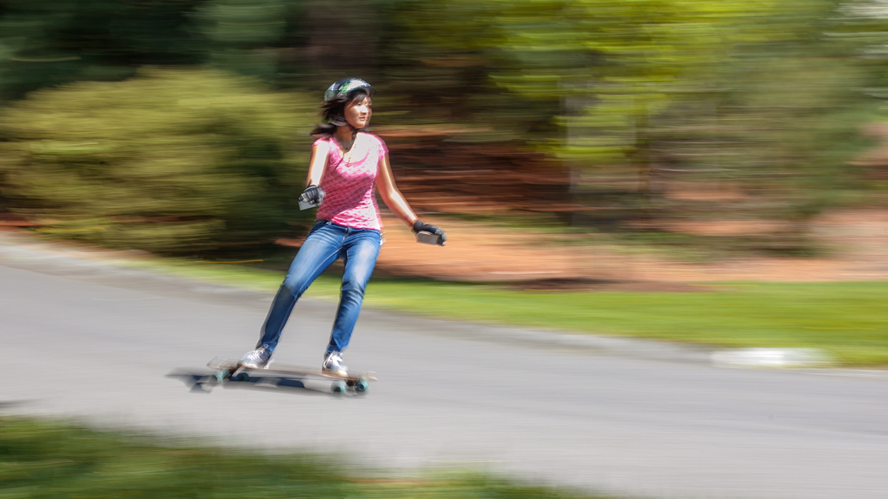 student skateboards down the road