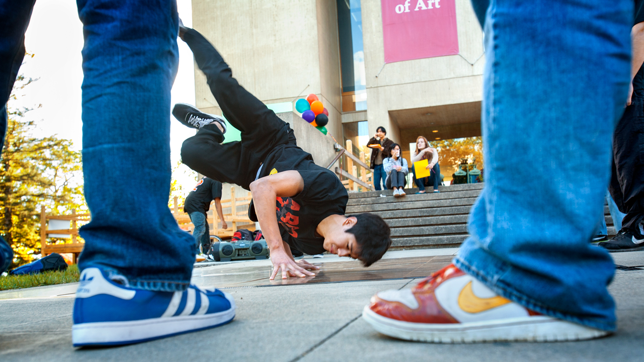 ground-level view of a student breakdancing