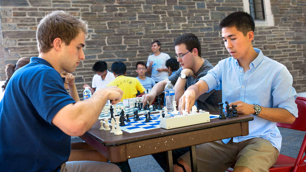 students play chess outdoors