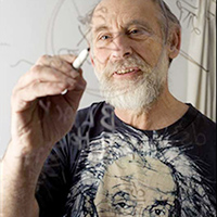 Leonard Susskind writes on a transparent board